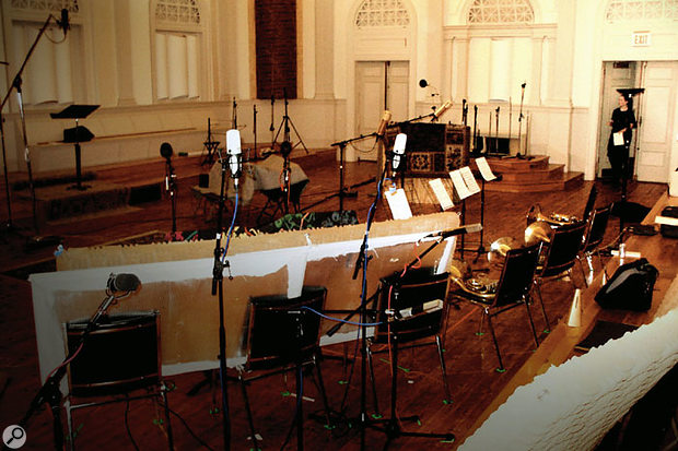 This photo was taken during the sessions for the library at Sonic Temple Studio, while the musicians were on a break, and shows the variety of mics and the acoustic baffles set up in the beautiful old hall.