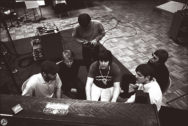 The Beach Boys learning parts from Brian Wilson around the piano at a SMiLE recording session, November 1966.