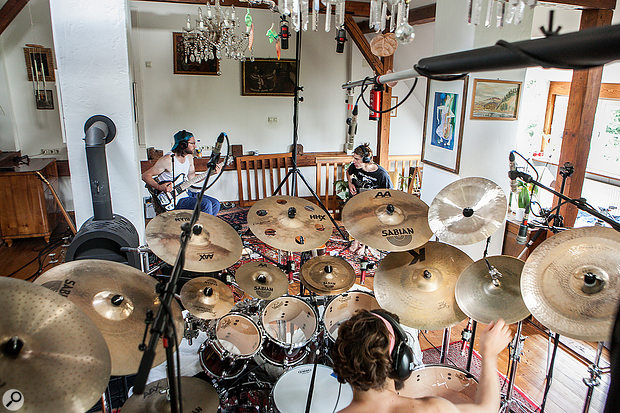 Mike used three overheads, rather than the more usual two, in order to capture a representative balance of Peter's large number of cymbals while maintaining the very close mic positions necessary to control room-ambience pickup.