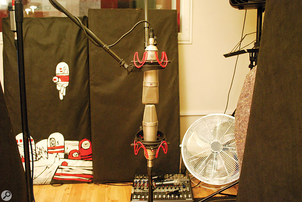 The Neumann U87 pair set up as an M-S array, with the upper one set to cardioid polar pattern, and the lower one to figure-of-eight and facing perpendicular to the kit.