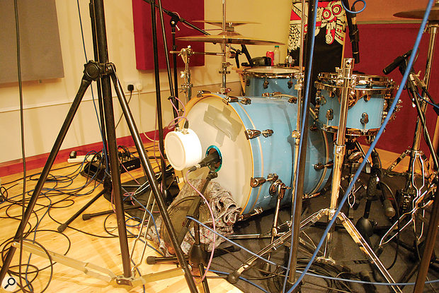 Keen to keep the contribution of the kick drum's resonant head, Neil used a Sennheiser MD421 to mic inside the small hole on that head, along with a sub-kick-style mic to fill out the low end that the first one seemed to lack.