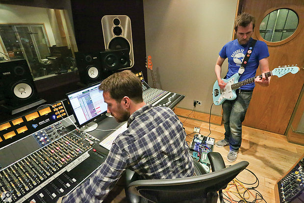 Both the guitar and bass overdubs were recorded with the player and amp heads in the control room, listening over the studio monitors, while the miked-up cabinets were sited across two other rooms.