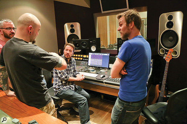 George (seated) discusses a track with High/Low in Kore's control room.