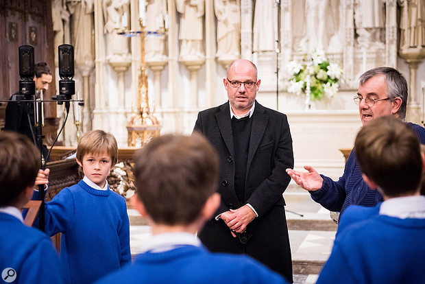 David Lol Perry (centre), Malcolm Archer (right) and the Winchester College Quiristers.
