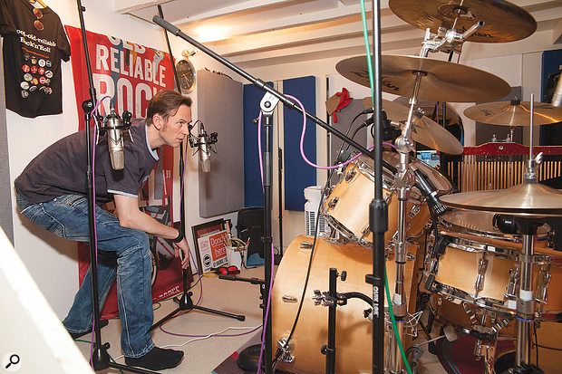 The task this month was to record rock drums in a tiny live room — so small, in fact, that Mike couldn't even stand up straight in it! Finding a good position for the main stereo pair of Rode NT2As was hard work, but here you can see their final position.