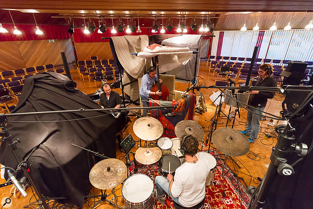 Here you can see the recording layout for the main band, comprising drum kit, upright bass, piano and sax. The singers and other instrumentalists were isolated in separate rooms.
