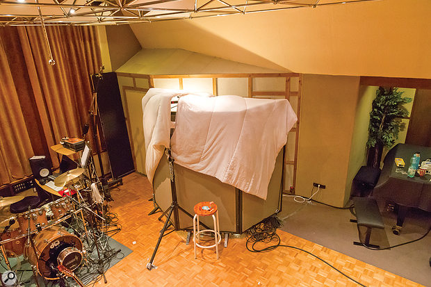 Because the studio's isolation booth added almost no reverb tail at all to Christian's guitar sound, a 'tent' was built around Tobi to eliminate the live room's natural ambience from his sound too, thereby matching the acoustics of the two spaces more closely.