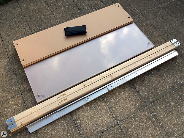 All the structural components of the baffle flatpacked, ready for transporting to the recording venue: the MDF and Perspex panels formed a  stack measuring about the same size as a  typical mineral-wool bass trap, while the bundle of cross-braces and profiling were around 170cm long.