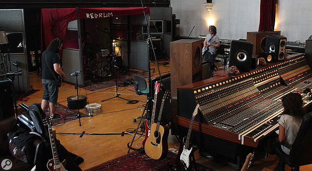 Riley looks on and listens from behind The Church Studio 1's EMI Neve console, while his Elephant Tree bandmates play through the track. A  key benefit of the open-plan layout is the ease of communication between the engineer and performers.
