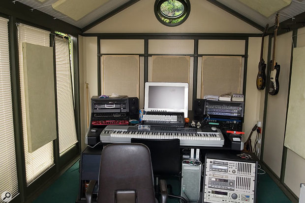 The main studio workstation desk in Midge Ure's personal studio, showing the positioning of Paul's five home-made acoustic panels.
