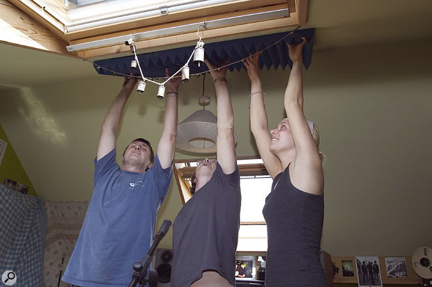 Tony and B helped Paul temporarily place some acoustic foam on the ceiling to see whether ceiling reflections were compromising the monitoring sound.