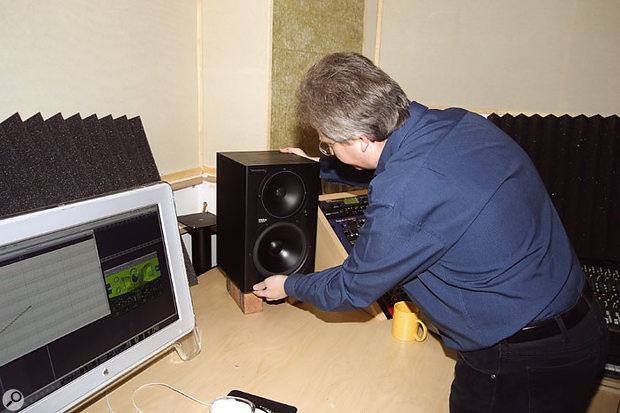 With the speakers mounted on their stands, reflections from the computer monitor and gear racks were interfering with the sound. By moving the speakers forward onto the desk, Hugh reduced this problem, and he also placed bricks under them to put the drivers at a better height for seated listening — these bricks also reduced the resonance of the table top on which the speakers were standing. For long-term use, Paul suggested routing holes into the table top and fitting the original speaker stands through the holes.