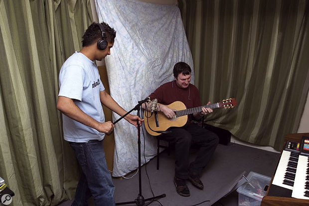 In order to improve Jazz and Alessia's acoustic guitar recordings, Paul set up an acoustic reflector (otherwise known as a spare desk shelf!) to liven up the sound reaching the mic. Paul then encouraged Jazz to move the mic around while listening to his playing on headphones, so that he could hear how much difference small position changes can make.