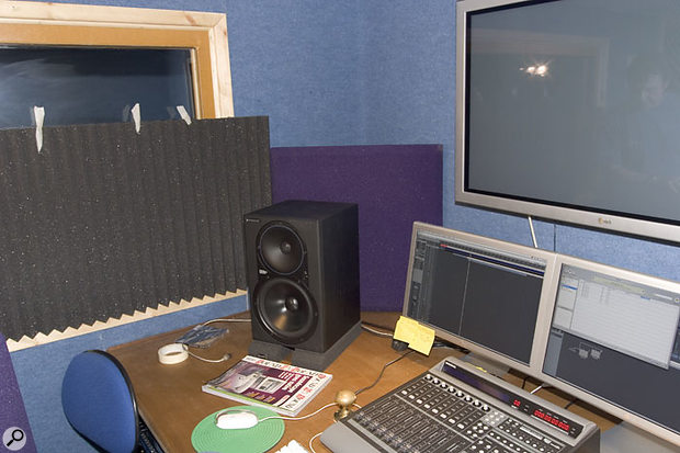 To get better response from Brett's Mackie HR824s, Paul & Hugh moved them away from the corners of the room, and placed them on some Auralex foam isolator pads. Acoustic foam was then placed on either side of the monitoring position to reduce reflections which were muddying the stereo image — although on the left side the panel was only fixed temporarily so that it wouldn't obstruct the sight line into the live room when tracking.