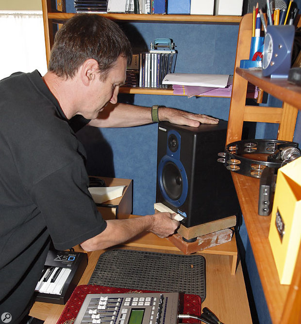 In order to treat a marked room resonance at 110Hz, each speaker was first isolated from the desk, which was exacerbating the problem, using two heavy quarry tiles separated by the speakers' rubber feet. A further improvement was made by inserting a small piece of acoustic foam into each speaker's reflex port, raising the low-frequency roll-off point.