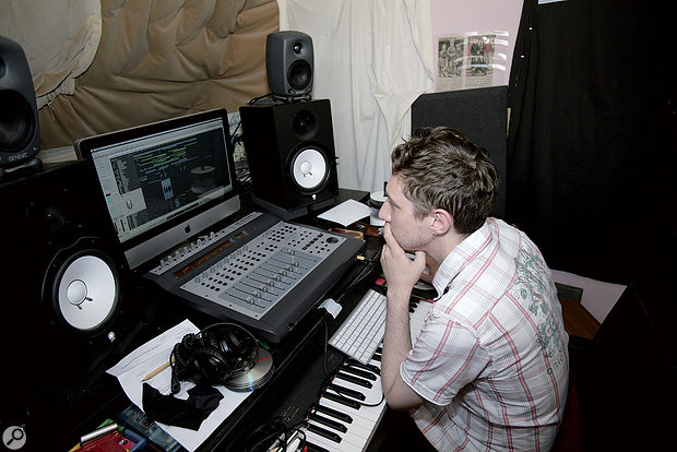 After: Matthew in his newly reconfigured studio. The Genelecs were placed on top of the Yamaha monitors, but angled down towards the listening position, while the Yamahas themselves were moved forward, which minimised the amount of sound being reflected off the desk.