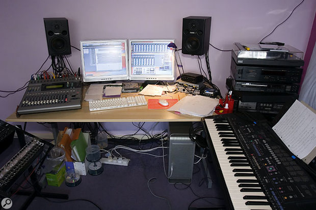 Ray's studio before the imminent 'pimping', with a Yamaha 01V digital mixer, an M-Audio 410 interface and a computer running Cubase SX at its heart.