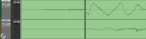 The snare top and bottom mics have produced quite different waveforms, but there's enough visual information here to suggest that reversing the polarity on the bottom mic and moving it a few samples ahead might create a better alignment.