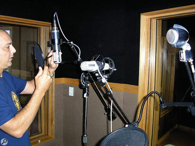 Toby Wright puts the finishing touches to a mic array for vocal recording. Left to right: an original custom-made Soundelux U95, a Telefunken (not Sennheiser, though they are identical) 421, and a Shure crystal mic dating from around 1942.