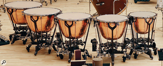 Timpani play a vital role in orchestral music. A pedal attachment enables these tuned drums to change pitch quickly during a performance.