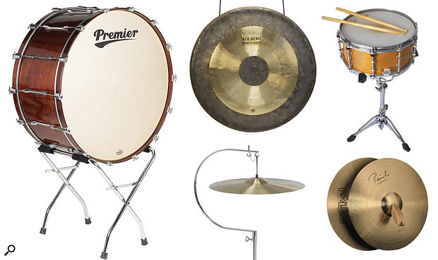Five staple orchestral percussion instruments. Clockwise from the left: bass drum, tam-tam gong, side drum, piatti cymbals, suspended cymbal (not to scale).