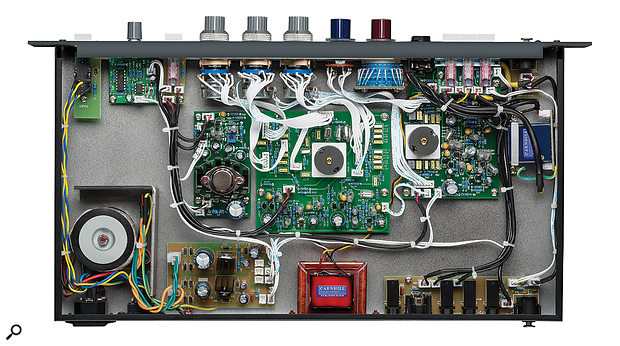 A peep inside the unit reveals high-quality components, including switched controls, two inductors and apair of Carnhill transformers.
