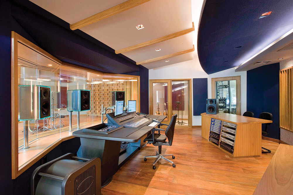 Figure 9: The control room at Diante Do Trono Studios in Brazil, created by the Walters-Storyk Design Group, uses angled side walls, plus combinations of absorption and diffusion on the ceiling and rear walls, to create a reflection-free zone. Note that the speakers are flush-mounted within a huge glass surface, which prevents the control room sounding 'dead' to the engineer.
