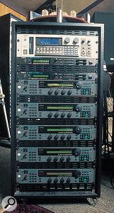Top: Akai S1100 sampler. Below: 2x Roland JV880, followed by 5x Quasimidi Quasar synth modules.