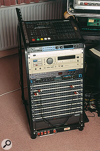 The outboard rack: from top, BRC remote controller for ADATs, Lexicon PCM91 reverb, SoundLink converter box for Korg 1212 I/O card, Panasonic DAT recorder, Alesis Midiverb III effects, MOTU MIDI Timepiece. Behind the rack (top left) are the Joemeek Voice Channel and Yamaha TX7 synth module.