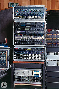 A selection of Street's gear: from top, TL Audio Classic dual valve EQ and Indigo VP2051 voice processor, Empirical Labs Distressor compressor, Emu Vintage Keys and Proteus FX synth modules, Yamaha SPX900 multi‑effects, Antares ATR1 Auto‑Tune intonation processor, Novation BassStation Rack, Zoom Studio 1201 effects, Mutronics Mutator filter bank, Ensoniq DP2 effects, SPL Transient Designer dynamics processor, and two more Distressors.