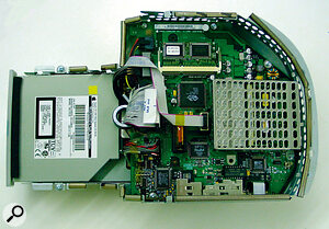 ... revealing the old processor card, under its protection grille (right).