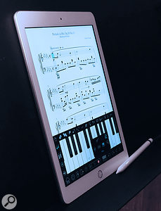 Apple iPad 6th Generation 9.7-inch with Apple Pen stylus.