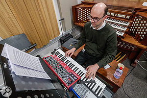 Art Of Moog member Martin Perkins, in rehearsal with one of the Nord Lead A1s that were so well suited to the project. The three-manual practice organ in the background was not used...
