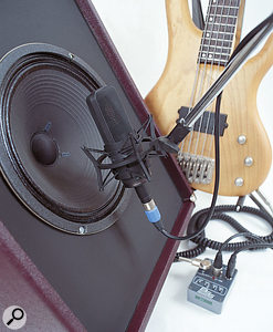 It makes sense to DI the signal from your bass guitar, as it will pick up all of the low-frequency information. Miking an amp can result in a lovely sound, though, so you might want to combine the signals. As with any multiple-source techniques, you need to be careful to get the phase relationship right.