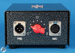 The included PSU features a nine-position 'chicken-head' knob for selecting the mic's polar pattern.