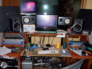 Charlie Andrew's control area at Iguana is connected to all the other rooms, allowing quite a lot of flexibility when it comes to recording. He works mostly 'in the box' using a Pro Tools HD rig; the small amount of outboard visible comprises multi-channel mic preamps, plus a multi-channel headphone amp (right) and monitor switcher (centre).
