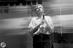 Mark E Smith on stage at Manchester GMEX, 1986.
