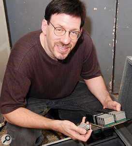 GX1 voices were programmed onto matchbox-sized cartridges. Each cartridge had 26 screw-sized dials on it to change the VCO, VCF, VCA and envelope of the voice. Seventy cartridges in total were loaded into racks that emerged from the top of the console. Rob Arbittier demonstrates how the GX1 modules are inserted.