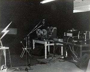 The TG studio at 10 Martello Street, Hackney, 1977. Equipment left to right: Beyer and Shure microphones, Custom wedge monitor, Revox A77 Stereo reel–to–reel, Teac A3340 four–track reel–to–reel, Leak Stereo 70 amplifier, self–built Graphic EQ, WEM Copicat, Roland RE301 Space Echo, Maestro Echoplex, Eventide H910 Harmonizer, Custom wedge monitor.