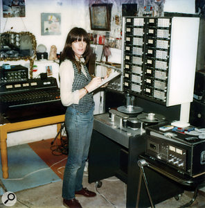 Cosey Fanni Tutti at the Industrial Records studio, approximately 1980. Equipment, left to right: Boss CE2 Chorus Pedal, Roland RE301 Space Echo, Teac Mixing desk, Studer 16-track (rented from Britannia Row), Teac A650 cassette deck.