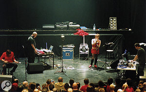 A reunited Throbbing Gristle performing at The Astoria Theatre, London, 16th May 2004. Left to Right: Cosey Fanni Tutti, Peter Christopherson, Genesis P–Orridge, Chris Carter.
