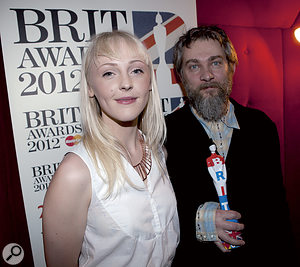 His work has gained Ethan Johns recognition from the industry: here he receives the 2012 MPG and Brit Award for Producer of the Year from Laura Marling.