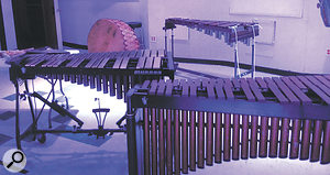 Marimba (front right) with two xylophones creeping up behind. The large drum at the back may or may not be the library's Native American Taos drum!
