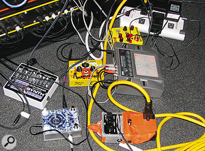 Some of the stomp boxes and processors used in recording The Dark Side's instruments.