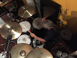 Much of Mike Bordin's drum sound on Sol Invictus was down to Bill Gould's choice of overheads — a  pair of cheap large-diaphragm capacitor mics fitted with copies of the AKG CK12 capsule found in the original C12.
