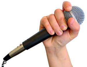 Vocal mics should be held along the body, as above, and not in such a way that the singer's hand cups the basket (below). Doing this blocks the mic's internal tuning ports, making the mic more omnidirectional and increasing the risk of feedback.