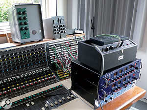 A selection of interesting vintage and modern studio gear perched on top of Will Gregory's Audix desk. Under the Maestro Echoplex tape delay to the right are visible a two-channel formant filter and three-way phaser, both made by Dan Wilson, and a Bel Digital Delay. Above the patchbay is a pair of Decca EQs racked by Neil Perry.