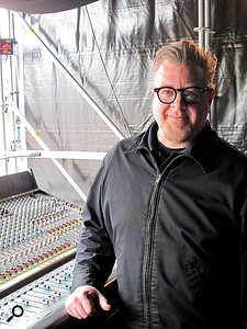 "Kevin Lemoine with his trusty Midas XL200 analogue console: ""I found this 32-channel XL200 in France and had it built back up to almost new by Jim Sawyer at Sawyer Audio."""