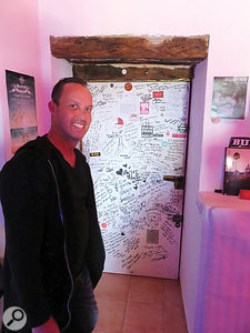 Sonic Vista owner Henry Sarmiento shows off the 'door of fame' signed by many of the studio's famous clients.