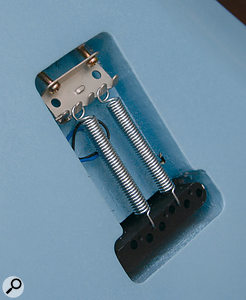 In Leo Fender's original tremolo design — apparently based on the spring mechanism used in bathroom scales — the springs are accessible via a panel on the rear of the Stratocaster.
